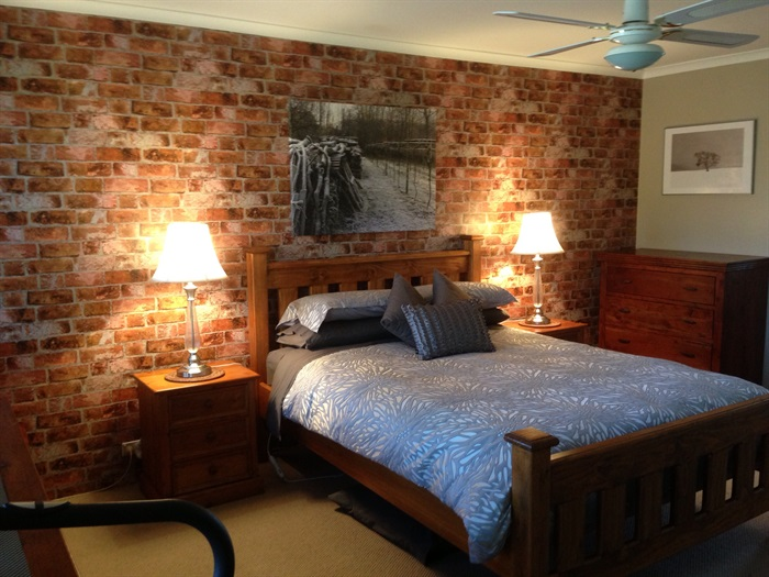 Teaser tuesday brick backsplash from down under Brick wall bedroom design