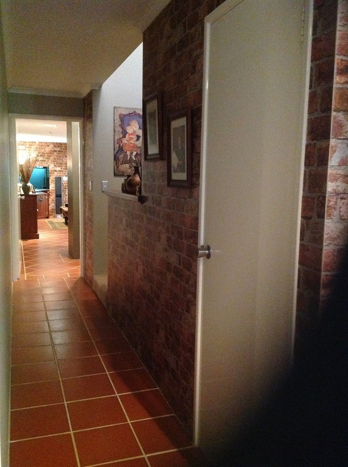 Hallway Decorated With Textured Brick Wallpaper