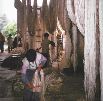Grasscloth Being Hand Woven In Asia